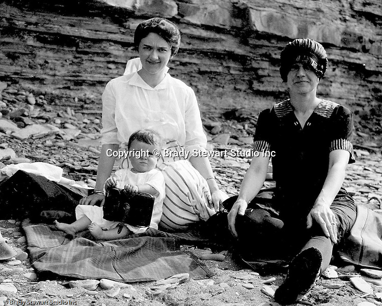 Erie PA:  Sarah and Helen Stewart relaxing on the Lake Erie shore with Sarah's sister.  Helen is holding one of Brady Stewart cameras - 1917.