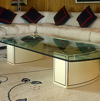 Detail of one of the glass topped coffee tables in the spacious living area