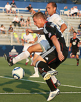 Danny Allsopp #9 of D.C. United tangles with Anthony Calvano #23 of the Harrisburg City Islanders during a US Open Cup match at the Maryland Soccerplex on July 21 2010, in Boyds, Maryland. United won 2-0.