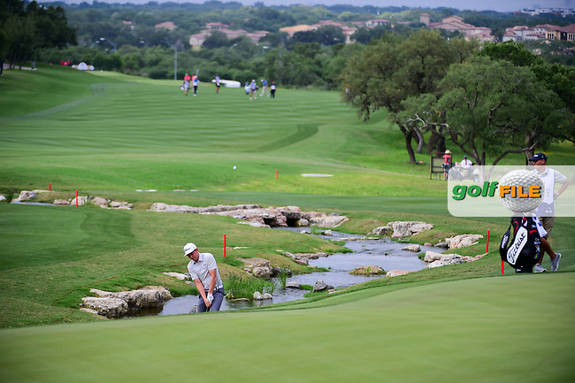 Cameron Smith (USA) hits from the creek on 18 during round 2 of the Valero Texas Open, AT&amp;T Oaks Course, TPC San Antonio, San Antonio, Texas, USA. 4/21/2017.<br /> Picture: Golffile   Ken Murray<br /> <br /> <br /> All photo usage must carry mandatory copyright credit (&copy; Golffile   Ken Murray)