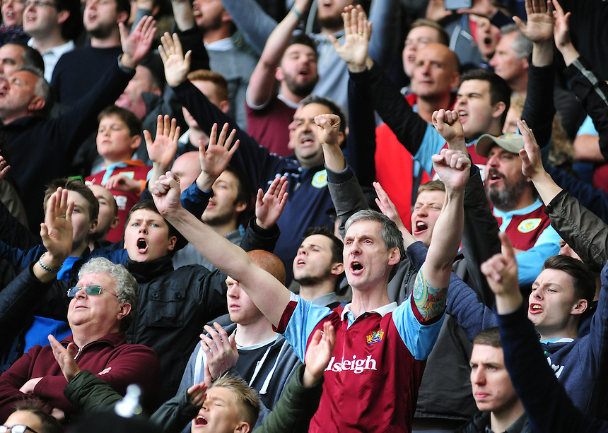 Burnley fans at the end of the game, before results of the other games confirmed their side had been relegated from the Premier League<br /> <br /> Photographer: Chris Vaughan/CameraSport<br /> <br /> Football - Barclays Premiership - Hull City v Burnley - Saturday 9th May 2015 - Kingston Communications Stadium - Hull<br /> <br /> &copy; CameraSport - 43 Linden Ave. Countesthorpe. Leicester. England. LE8 5PG - Tel: +44 (0) 116 277 4147 - admin@camerasport.com - www.camerasport.com
