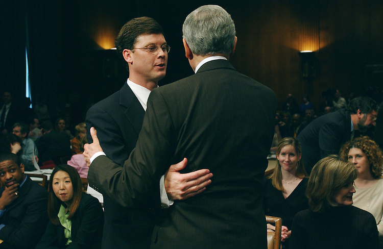 "3/14/02.PICKERING NOMINATION--In the Senate Judiciary meeting room just before the committee's business meeting to consider the nomination of Charles W. Pickering Sr. to be United States Circuit Court Judge for the 5th Circuit, his son, U.S. Rep. Charles W. ""Chip"" Pickering Jr., R-Miss., left, and committee ranking Republican Orrin G. Hatch, R-Utah, embrace..CONGRESSIONAL QUARTERLY PHOTO BY SCOTT J. FERRELL"