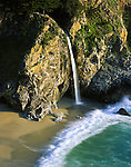 McWay Falls from McWay Creek spilling into the Pacific Ocean at Julia Pfeiffer Burns State Park (1800 acres). Falls; 80 ft (24m), year-round. Julia Pfeiffer Burns was a practical and respected frontier woman after whom the park was named by donor and friend Helen Hooper Brown. Big Sur Coast, Highway One, Monterey County, CA.