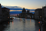 Early morning on the Grand Canal in Venice, Italy..Showing San Maria della Salute with dome in Scaffolding. May 2007