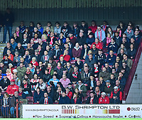 Lincoln City fans watch their team in action<br /> <br /> Photographer Andrew Vaughan/CameraSport<br /> <br /> The EFL Checkatrade Trophy Northern Group H - Scunthorpe United v Lincoln City - Tuesday 9th October 2018 - Glanford Park - Scunthorpe<br />  <br /> World Copyright &copy; 2018 CameraSport. All rights reserved. 43 Linden Ave. Countesthorpe. Leicester. England. LE8 5PG - Tel: +44 (0) 116 277 4147 - admin@camerasport.com - www.camerasport.com