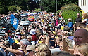 Grand Depart - Tour de France 2014<br /> Yorkshire England.<br /> Leaders go through famous town of Ilkley with Moors in distance.<br /> <br /> Peloton go through massive crowds lining the streets<br /> <br /> Pic by Gavin Rodgers/Pixel 8000 Ltd