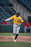 AZL Athletics left fielder Lawrence Butler (23) releases his bat after drawing a walk during an Arizona League game against the AZL Angels at Tempe Diablo Stadium on June 26, 2018 in Tempe, Arizona. The AZL Athletics defeated the AZL Angels 7-1. (Zachary Lucy/Four Seam Images)