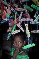 PEMBA, TANZANIA - DECEMBER 6 : A girl stands in the door of a shop on December 6, 2010 on Pemba, Tanzania. (Photo by: Per-Anders Pettersson