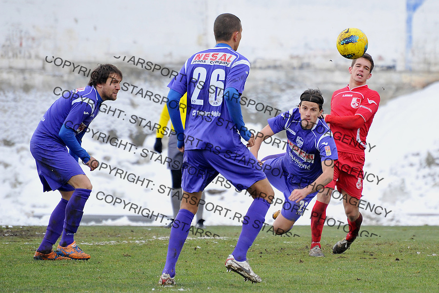 Fudbal Super liga season 2013-2014<br /> Novi Pazar v Radnicki Nis<br /> Milos Obradovic (#21) FK Novi Pazar ispucava loptu<br /> Novi Pazar, 7. 12. 2013<br /> foto: Emir Sadovic/Starsportphoto &copy;