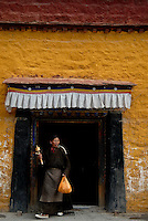 Images from the Book Journey Through Colour and Time, Women leaving the large prayer wheel Building one of many in the Lhasa area, Tibet