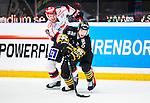 Stockholm 2014-09-11 Ishockey Hockeyallsvenskan AIK - S&ouml;dert&auml;lje SK :  <br /> AIK:s Victor Ekarv i kamp om pucken med Simon L&ouml;f <br /> (Foto: Kenta J&ouml;nsson) Nyckelord:  AIK Gnaget Hockeyallsvenskan Allsvenskan Hovet Johanneshovs Isstadion S&ouml;dert&auml;lje SK SSK
