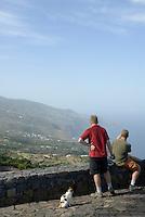 Spain, Canary Islands, La Palma, La Tosca near Barlovento: view point, north coast, two men, one cat