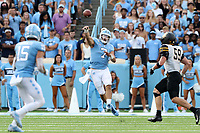 CHAPEL HILL, NC - SEPTEMBER 21: Sam Howell #7 of the University of North Carolina throws a pass to Beau Corrales #15 during a game between Appalachian State University and University of North Carolina at Kenan Memorial Stadium on September 21, 2019 in Chapel Hill, North Carolina.