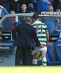 Ally McCoist commiserates with Charlie Mulgrew afrer the Celtic man's red card