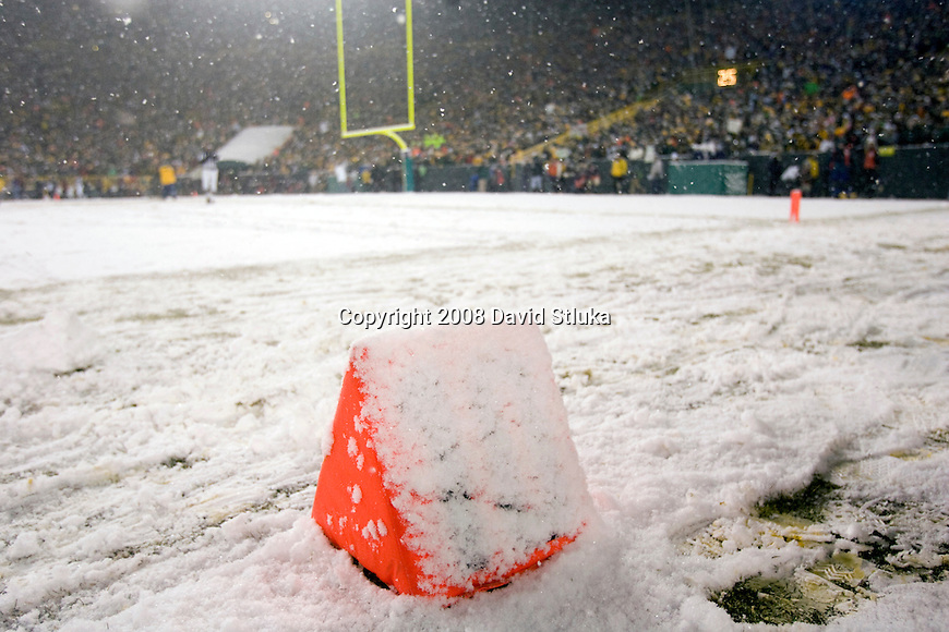 A view of the snow covered 10 yard line marker at Lambeau Field during an unexpected snow storm during the Green Bay Packers game against the Seattle Seahawks during the NFC divisional playoff game on January 12, 2008 in Green Bay, Wisconsin. The Packers beat the Seahawks 42-20. (AP Photo/David Stluka)