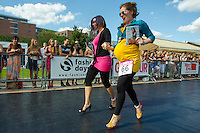 A pregnant participant attends the yearly Stiletto Run organized by Glamour magazine in Budapest, Hungary on September 08, 2012. ATTILA VOLGYI