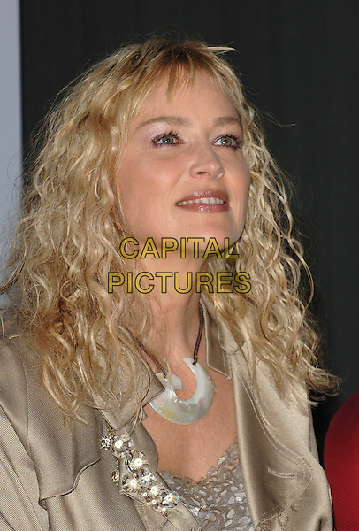 "SHARON STONE.At a press conference to announce the release of celebrity supported charity song, ""Come Together"" proceeds of which will go to the Katrina Hurricane Disaster Relief, held at the Roosevelt Hotel, Hollywood, CA..October 17th, 2005.Ref: MOO.headshot portrait necklace jewellery.www.capitalpictures.com.sales@capitalpictures.com.©Capital Pictures."