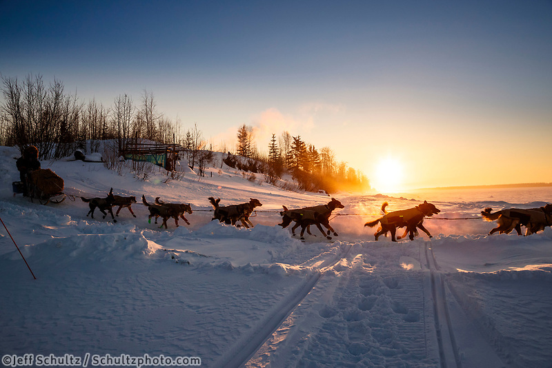 Jodi Bailey leaves the Tanana checkpoint at sunrise and drops onto the Yukon River during the 2017 Iditarod on Wednesday morning March 8, 2017.<br /> <br /> Photo by Jeff Schultz/SchultzPhoto.com  (C) 2017  ALL RIGHTS RESERVED