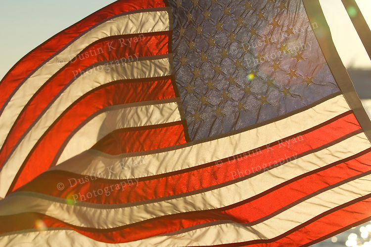American Flag backlit and flying in the wind