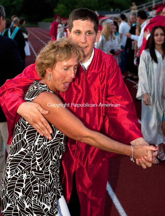 WOLCOTT, CT 18 JUNE, 2010-061810JS07-Wolcott High School graduate Michael Febbriello dances with Wolcott High School nurse Kathy Fawcett as he celebrates following graduation ceremonies at Wolcott High School in Friday. <br /> Jim Shannon Republican-American