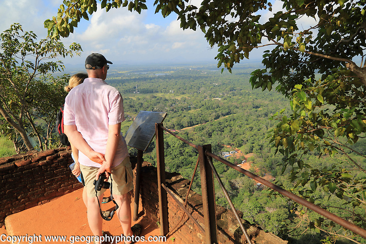 Two people looking down at the water gardens from rock palace fort, Sigiriya, Central Province, Sri Lanka, Asia