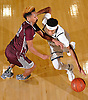 Shane Gatling #11 of Baldwin, right, gets pressured by Darien Jenkins #12 of Deer Park during the penultimate game in the Tip of the Hat Classic at Adelphi University on Sunday, Jan. 10, 2016.