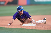 Tulsa Drillers second baseman Taylor Featherston (12) slides into third during the second game of a doubleheader against the Frisco Rough Riders on May 29, 2014 at ONEOK Field in Tulsa, Oklahoma.  Frisco defeated Tulsa 3-2.  (Mike Janes/Four Seam Images)