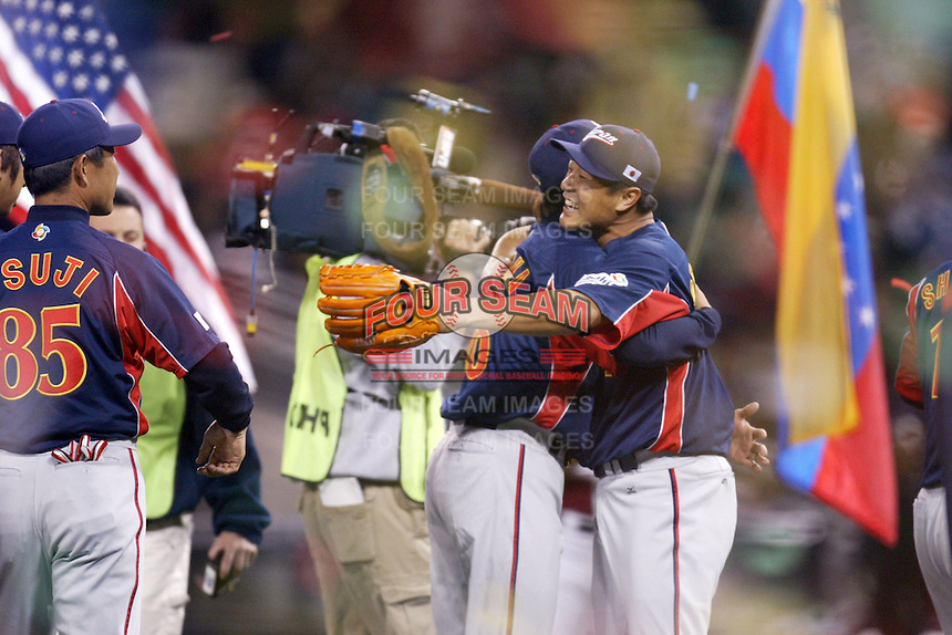 Daisuke Matsuzaka and Akinori Otsuka of Japan during World Baseball Championship at Petco Park in San Diego,California on March 20, 2006. Photo by Larry Goren/Four Seam Images