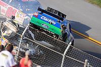 Apr 26, 2009; Talladega, AL, USA; NASCAR Sprint Cup Series driver Carl Edwards (99) goes airborne on the last lap during the Aarons 499 at Talladega Superspeedway. Mandatory Credit: Mark J. Rebilas-