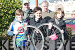 WHEELS: Helping out at the Matt Lacey Bicyle Cup race on Sunday on the Tralee-Dingle Road, were, Fionn,Ron and Mary van der Noll, Noel Keane and Orla van der Noll.................................. ....