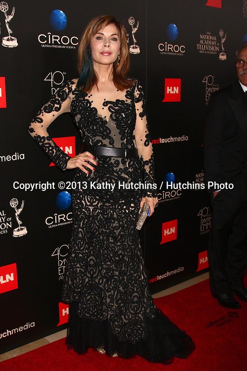 LOS ANGELES - JUN 16:  Lauren Koslow arrives at the 40th Daytime Emmy Awards at the Skirball Cultural Center on June 16, 2013 in Los Angeles, CA
