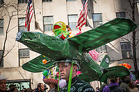 A man displays his hat's decoration while people attend the annual easter parade in Manhattan, New York, 03.27.2016. This annual tradition has been taking place in New York City for over 100 years, Photo by VIEWpress/Maite H. Mateo.
