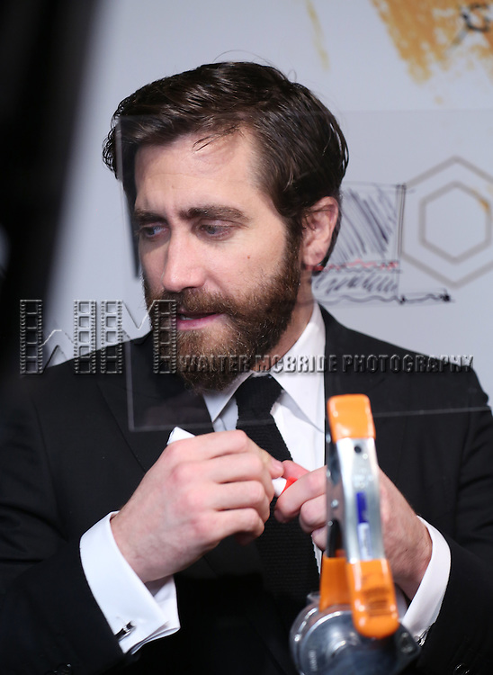 Jake Gyllenhaal draws a Hat Doodle at the 'Sunday In The Park With George' Broadway opening night after party at New York Public Library on February 23, 2017 in New York City.