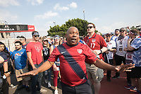 MEXICO CITY, MEXICO - June 11, 2017: USA soccer fan Gerald Foston gives instructions to other  USA fans before the World Cup Qualifier match against Mexico at Azteca Stadium.