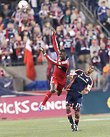 Chicago Fire defender Jalil Anibaba (6) and New England Revolution forward Jerry Bengtson (27) battle for head ball. In a Major League Soccer (MLS) match, the New England Revolution (blue) defeated Chicago Fire (red), 1-0, at Gillette Stadium on October 20, 2012.