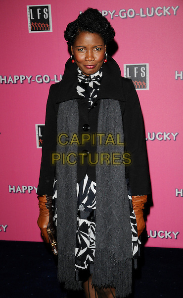 "SARAH NILES .At the UK Film Premiere of ""Happy-Go-Lucky"" held at the Odeon Leicester Square, London, England, .April 14th 2008..Happy Go Lucky half length 3/4 grey scarf black jacket and white print dress brown gloves  .CAP/CAN.©Can Nguyen/Capital Pictures"