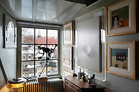 A guest room on the top floor has a view of the old centre of Haarlem.  The room is decorated with a 19th century weathervane depicting a blacksmith, a monochrome still-life by Olav Cleofas van Overbeek, dated 1990 and paintings by Metten Koornstra