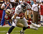 San Francisco 49ers defensive end Andre Carter (96) sacks Denver Broncos quarterback Brian Griese (14) on Sunday, September 15, 2002, in San Francisco, California. The Broncos defeated the 49ers 24-14.