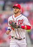 4 April 2014: Washington Nationals outfielder Bryce Harper trots back to the dugout between innings against the Atlanta Braves during the Nationals Home Opening Game at Nationals Park in Washington, DC. The Braves edged out the Nationals 2-1 in their first meeting of the 2014 MLB season. Mandatory Credit: Ed Wolfstein Photo *** RAW (NEF) Image File Available ***