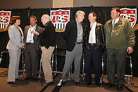 INDIANAPOLIS, IN - January 18, 2013: Panel members talk amongst themselves beforehand. From left: 1991 World Cup captain and 2003 World Cup coach April Heinrichs, 1995 and 1999 World Cup coach Tony DiCicco, 1950 World Cup captain Walter Bahr, 1990 World Cup coach Bob Gansler, 1991 World Cup coach Anson Dorrance, and 1998 World Cup coach Steve Sampson. U.S. Soccer hosted a World Cup Coaches and Captains panel at the Indiana Convention Center in Indianapolis, Indiana during the NSCAA Annual Convention.