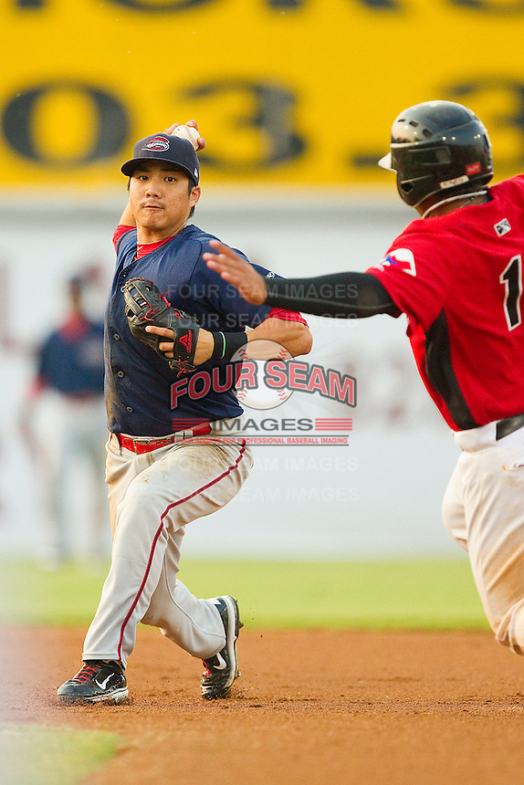 Second baseman James Kang #2 of the Greenville Drive turns a double play against the Hickory Crawdads at L.P. Frans Stadium on September 3, 2011 in Hickory, North Carolina.  The Crawdads defeated the Drive 3-0.  (Brian Westerholt / Four Seam Images)