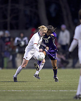 "Boston College midfielder Julia Bouchelle (12) and University of Washington midfielder Jane Mitchell (12) battle for the ball. In overtime, Boston College defeated University of Washington, 1-0, in NCAA tournament ""Elite 8"" match at Newton Soccer Field, Newton, MA, on November 27, 2010."