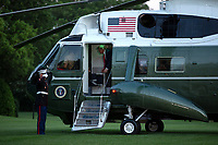 "United States President Donald J. Trump speaks before stepping off Marine One at the White House in Washington, D.C., U.S., as he arrives from the Kennedy Space Center in Florida on Saturday, May 30, 2020.  Trump vowed his administration would end what he called ""mob violence"" in U.S. cities following the death of an unarmed black man at the hands of Minnesota police, blaming leftist groups for clashes with police and property damage around the nation. <br /> Credit: Stefani Reynolds / Pool via CNP/AdMedia"