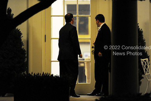 Two secret service agents stand still in front of the Oval Office before President Barack Obama returns to the White House, Wednesday, April 6, 2011 in Washington, DC. President Obama and Vice President Biden invited back Speaker John Boehner and Senate Majority Leader Harry Reid for a late meeting Wednesday night to discuss ongoing negotations on a funding bill to fund the government through the end of the fiscal year..Credit: Olivier Douliery / Pool via CNP