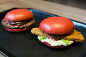 Burger King's two new red burgers, the AKA SAMURAI BEEF (left) and the AKA SAMURAI CHICKEN, went on sale on Friday July 3, 2015, in Tokyo, Japan. The two new burgers use red buns and red cheese, colored by tomato powder and spicy red sauce and will be sold at Japanese branches until August. The AKA SAMURAI CHICKEN costs 540 JPY (4.39 USD) and the AKA SAMURAI BEEF costs at 690 JPY (5.61 USD). As a part of the promotion Burger King plans to launch two new black burgers on August 21st. (Photo by Rodrigo Reyes Marin/AFLO)
