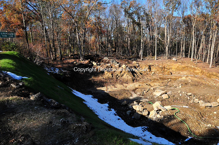 THOMASTON, CT, 04 NOV 11-110411AJ01- A pit nearly two acres across remains at the site of a Sept. 12 gasoline tanker crash off Route 8 in Thomaston.  Alec Johnson / Republican-American