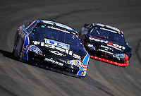 Oct. 10, 2009; Fontana, CA, USA; NASCAR Nationwide Series driver Steve Wallace leads Justin Allgaier during the Copart 300 at Auto Club Speedway. Mandatory Credit: Mark J. Rebilas-