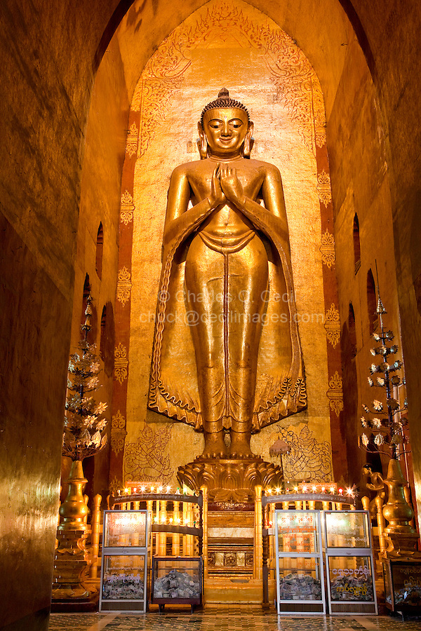 Myanmar, Burma. Bagan.  Buddha Statue, Ananda Temple, teak covered in gold leaf.  This is the Buddha on the south side of the temple, dating back to when the temple was built between 1090 and 1105.