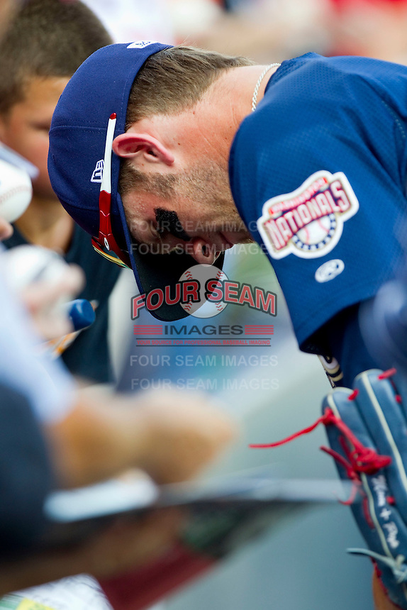 Bryce Harper #34 of the Harrisburg Senators signs autographs prior to the game against the Richmond Flying Squirrels in game one of a double-header at The Diamond on July 22, 2011 in Richmond, Virginia.  The Squirrels defeated the Senators 3-1.   (Brian Westerholt / Four Seam Images)