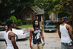 Atlanta rapper Ca$h Out seen with friends outside the West End of Atlanta, Georgia June 15, 2012.